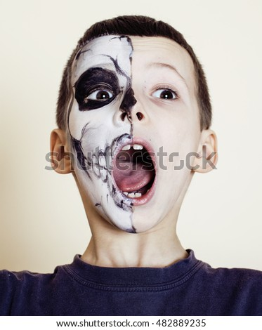 little cute boy with facepaint like skeleton to celebrate halloween, lifestyle people concept, children on holiday