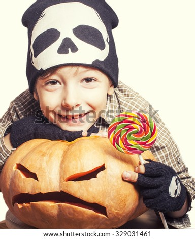 little cute boy with halloween pumpkin close up holding candy isolated, trick or treat - stock photo
