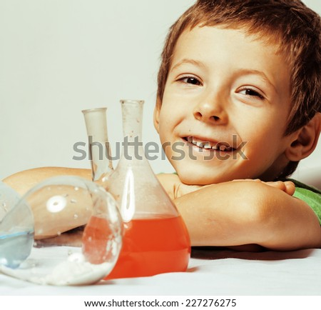 little cute boy with medicine glass isolated wearing glasses smiling - stock photo