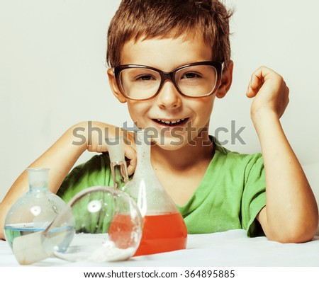 little cute boy with medicine glass isolated wearing glasses smiling close up genius kid - stock photo