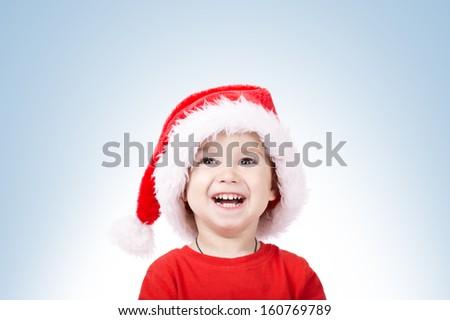 little cute boy with Santa hat - stock photo