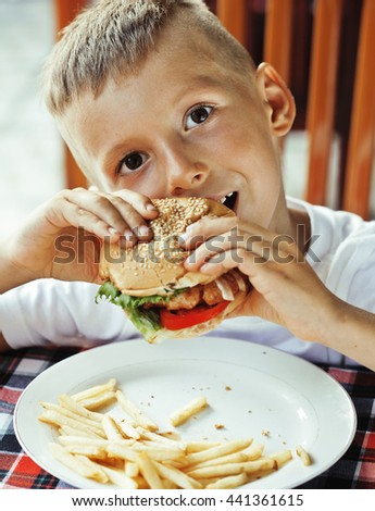 little cute boy 6 years old with hamburger and french fries maki - stock photo