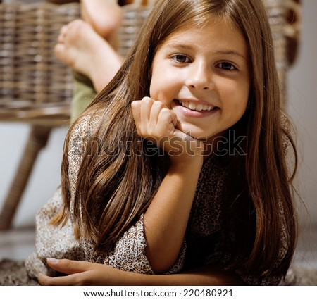 little cute brunette girl at home smiling close up - stock photo