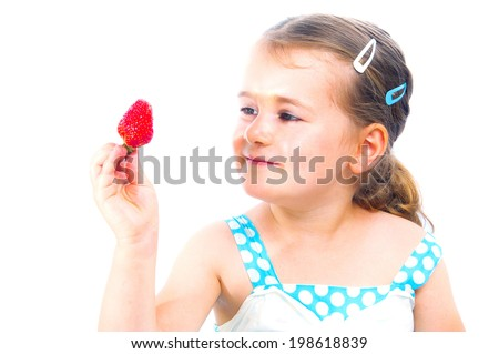 little cute child holding a strawberry, isolated on white  - stock photo