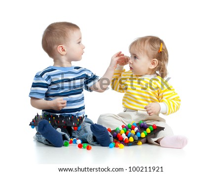 Little cute children play together