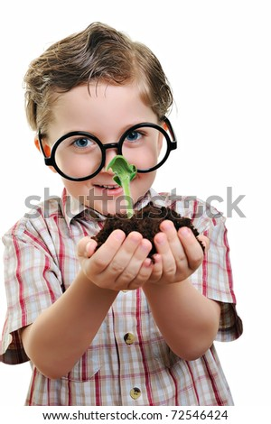 Little cute geeky child holding green plant in hands - stock photo
