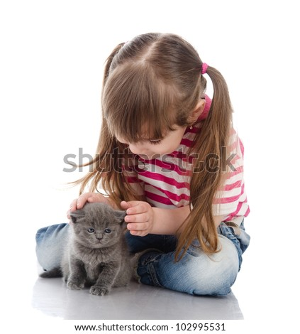 little cute girl affectionately hugging kitten.  isolated on white background - stock photo