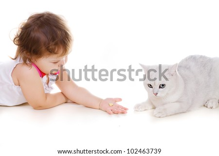 Little cute girl and a cat laying on the floor - stock photo