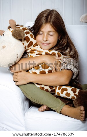 little cute girl at home smiling - stock photo