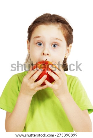 Little cute girl bites a big red apple with appetite - stock photo