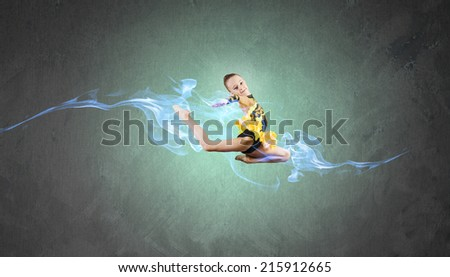 Little cute girl gymnast making high jump