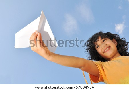 Little cute girl holding an airplane - stock photo