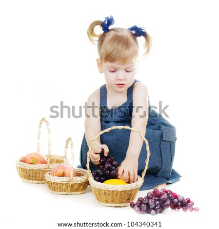 little cute  girl holding three baskets with fruits - stock photo