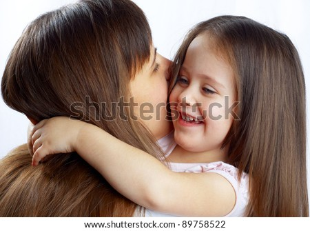 little cute girl hugging her mother's neck - stock photo