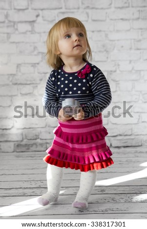 little cute girl in a dress. Studio shoot, christmas concept