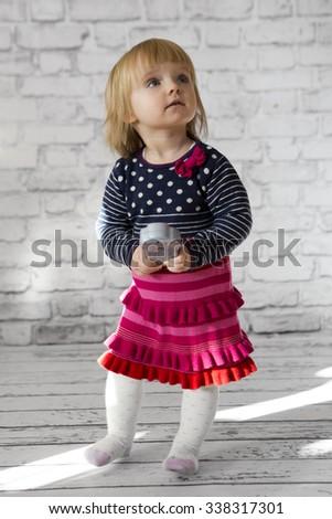 little cute girl in a dress. Studio shoot, christmas concept - stock photo