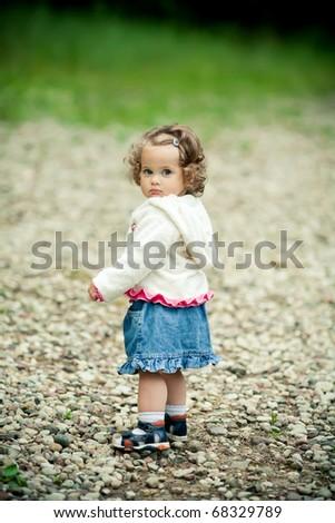 little cute girl in park - stock photo