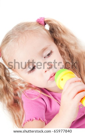Little cute girl in studio - stock photo