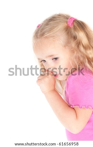 Little cute girl in studio eating candy
