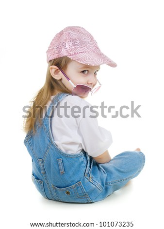 Little cute girl in sunglasses and hat - stock photo
