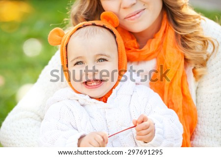 Little cute girl in the autumn park . The child with the big eyes. - stock photo