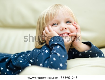 Little cute girl is daydreaming - stock photo