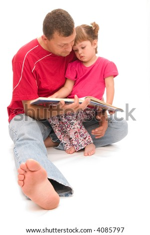 little, cute girl listening to her father reading fairy tale