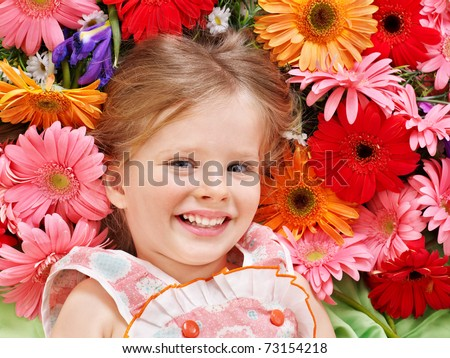 Little cute girl lying on the flower. - stock photo