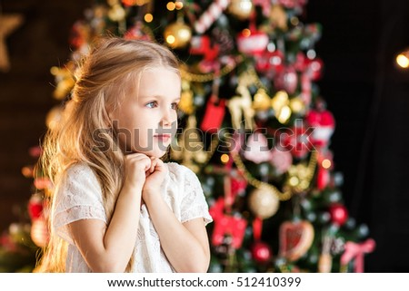 Little cute girl near christmas tree