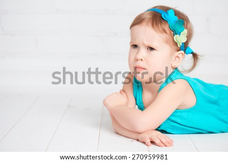 little cute girl offended, angry and frown - stock photo