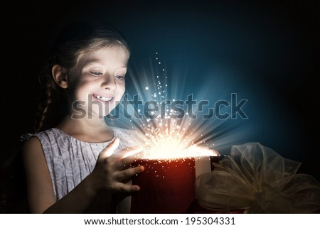 Little cute girl opening Christmas gift box - stock photo
