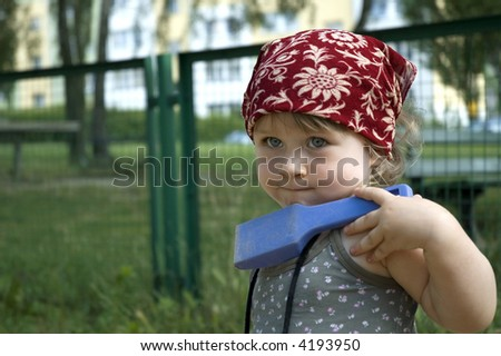little cute girl playing at the playground - stock photo