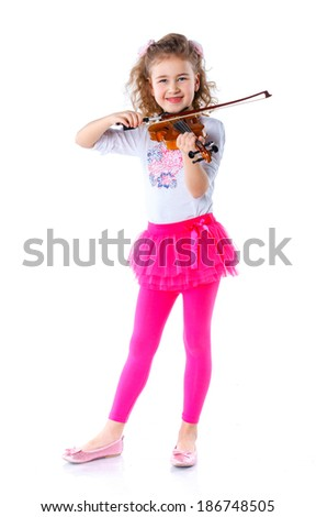 Little cute girl playing the violin isolated on white.