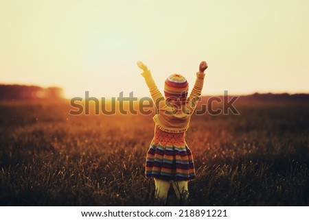 little cute girl runnig to the sunset - stock photo