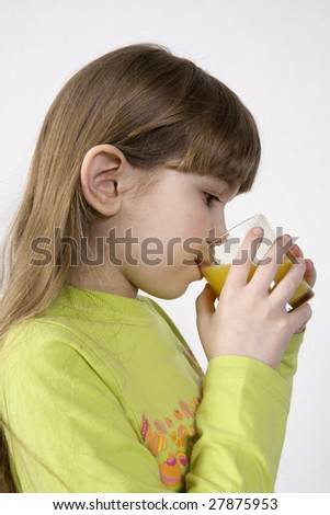 little cute girl seven years old drink orange juice