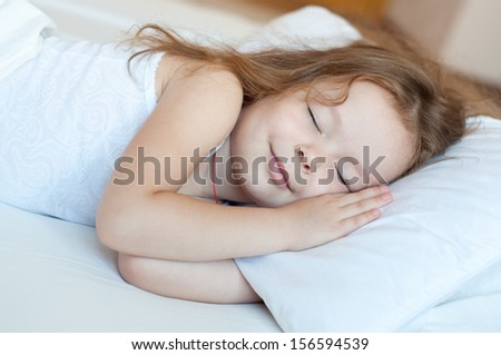 little cute girl sleeping in white bed - stock photo
