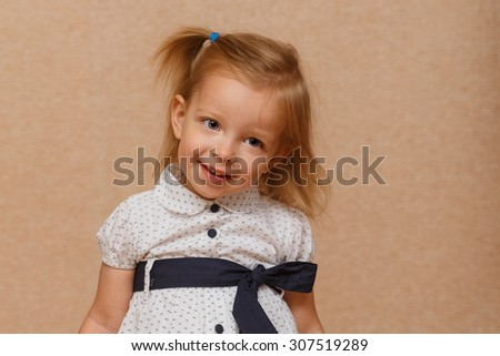 Little cute girl smiling. Positive emotions. The concept of carefree childhood. - stock photo