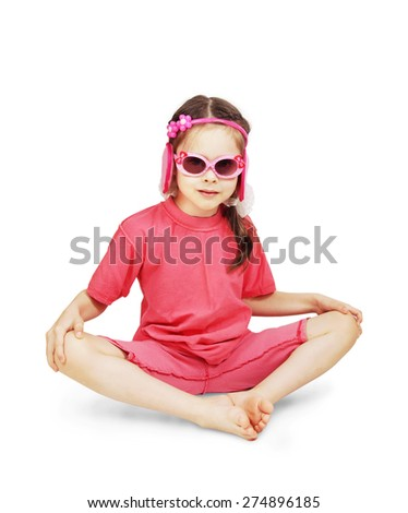 Little cute girl wearing pink clothes sitting over white background - stock photo