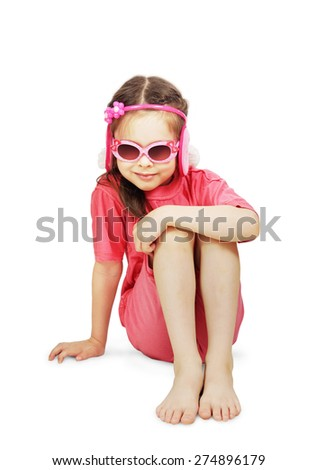 Little cute girl wearing pink clothes with a sunglasses is sitting - stock photo