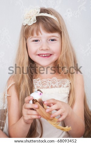 little cute girl wearing vintage suit holding small toy bird - stock photo
