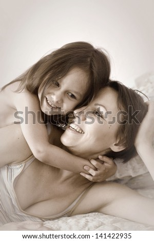 little cute girl with her mother at home - stock photo
