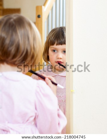 Little cute girl  with  makeup brush - stock photo