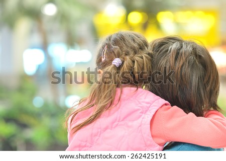 Little cute girl with mother in park, back view - stock photo
