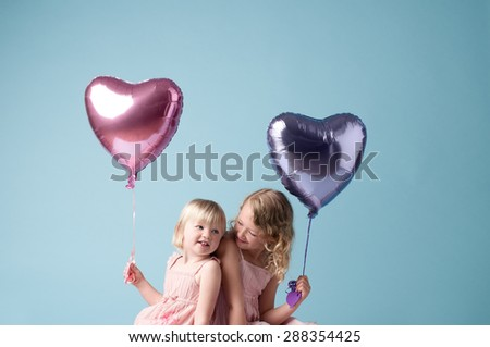 Little Cute Girls Playing with Balloons - stock photo