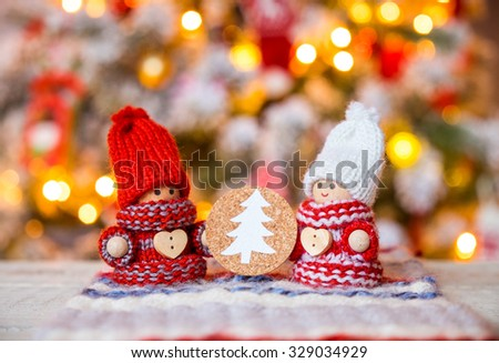 Little cute gnomes at christmas tree background - stock photo