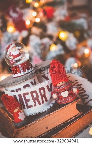 Little cute gnomes snow ball with Santa at christmas tree background - stock photo