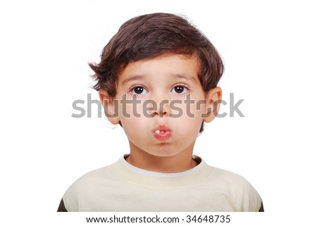 Little cute kid eating with filled mouth - stock photo
