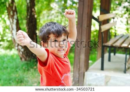 Little cute kid with angry expression and hands