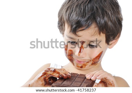 Little cute kid with chocolate on face and hands - stock photo