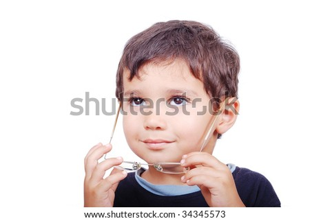 Little cute kid with wearing glasses - stock photo